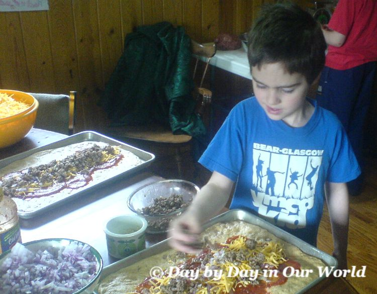 Give a child an age appropriate task so they can be an active participant in cooking