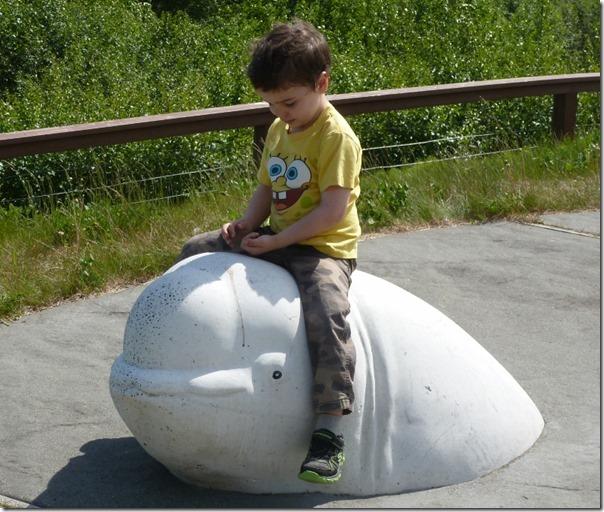 J Sitting on a Beluga Whale Statue Head Bird Point Alaska