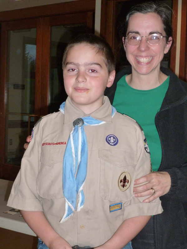 D Poses with Mom after getting Tenderfoot Rank at the Court of Honor