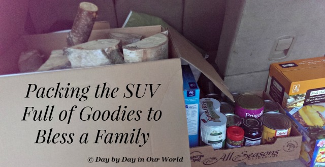 Packing the SUV Full of Goodies to Bless a Family