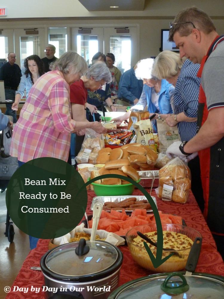Crock-Pot Bean Mix Ready to Be Consumed at a Church Summer Potluck