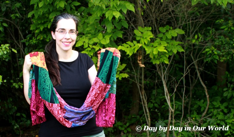 Holding Trades of Hope Scarf to show off the length