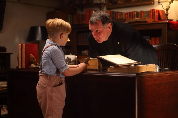 Little Boy receives the list from Father Oliver