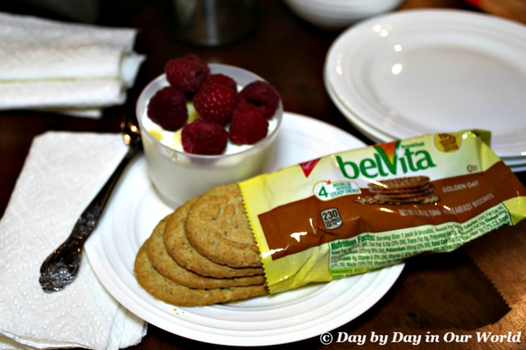 Gathering all parts of a nutritious start to the day including Greek yogurt with raspberries and belVita Breakfast Biscuits.