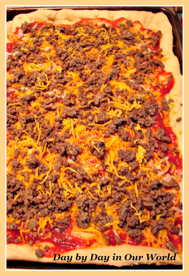 Cheeseburger Pizza ready for the oven.