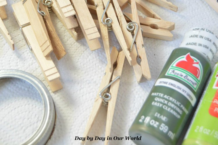 Gather all your materials and prepare your workspace for making the clothespin vase.