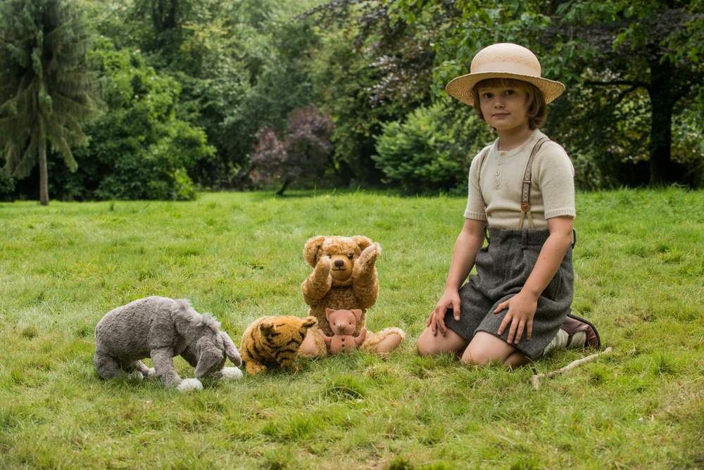 Playing with toys in the woods in Goodbye Christopher Robin