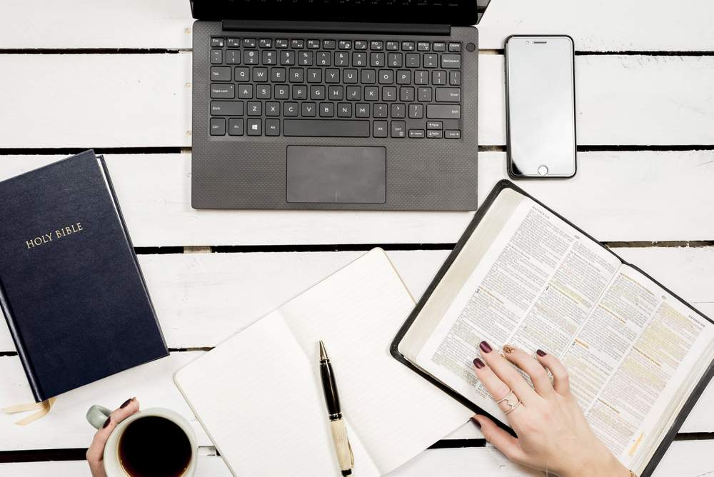 Bible Laptop and Journal to Deepen Spirituality