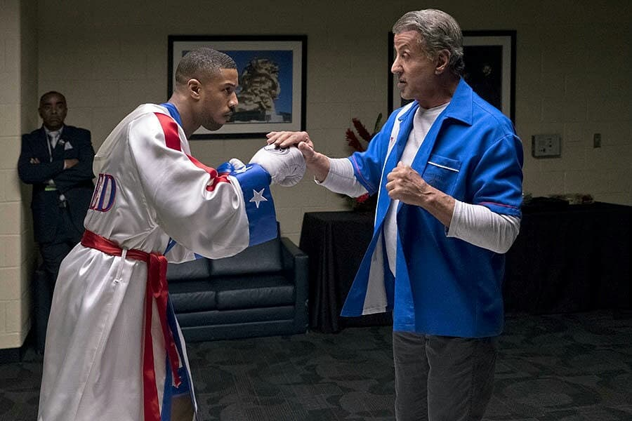 Rocky helps Adonis Creed prepare to face an opponent.